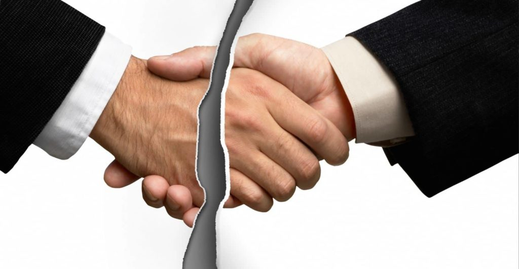 a tear-up photo of a close up of two person shaking hands