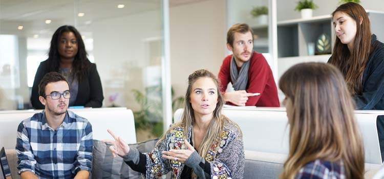 a group shot of employee talking in a causal setting