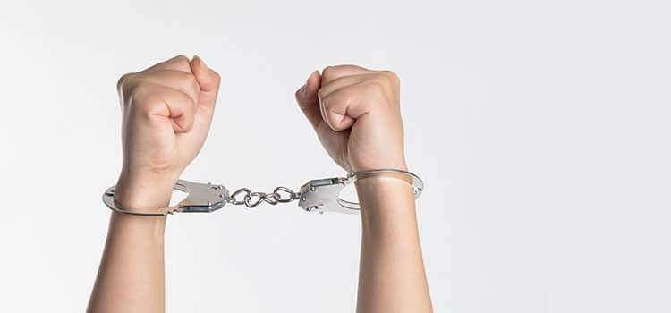 a pair of hand that are handcuffed