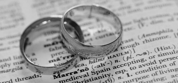 a close up of a pair of engagement rings