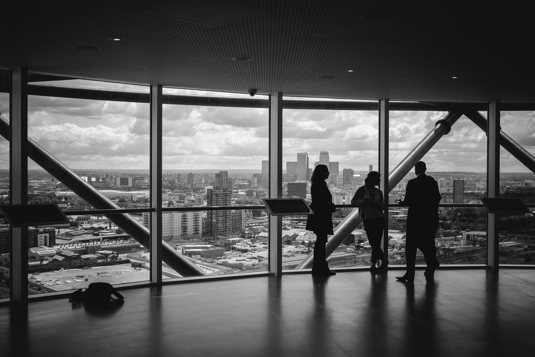 Black and white photo of people standing overlooking singapore skyline