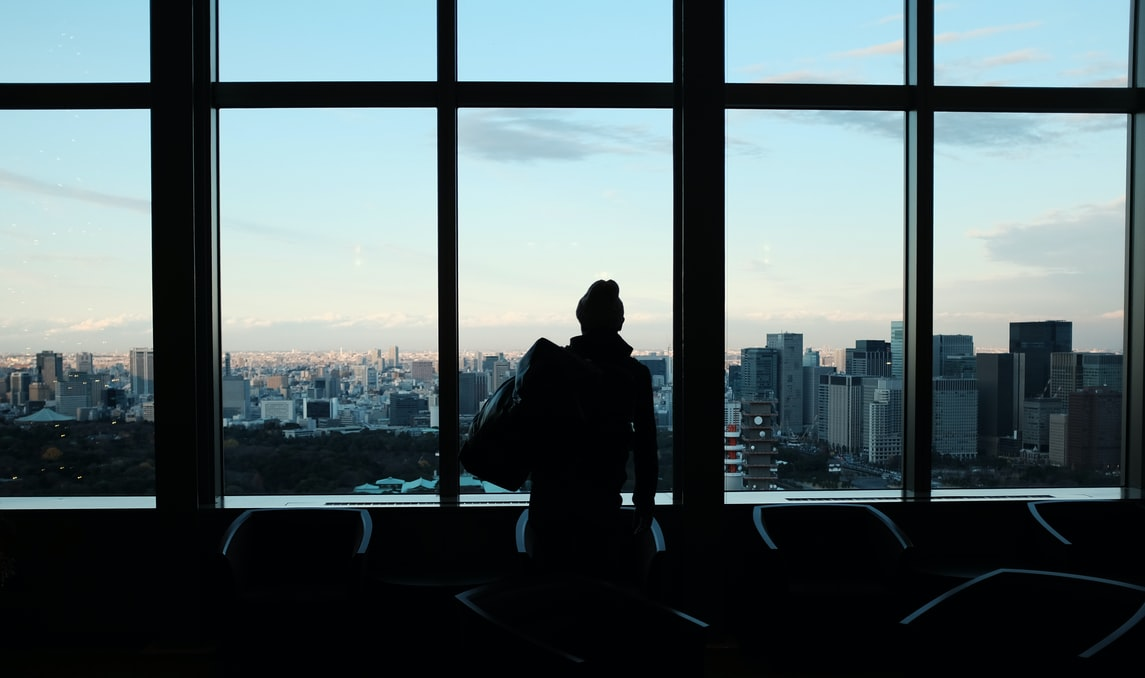 silhouette of a man overlooking singapore skyline